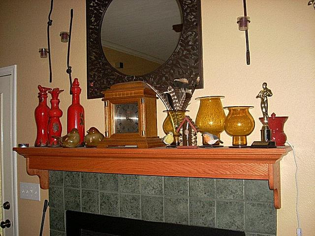 Mantle, Entertainment Center and Glass Case
