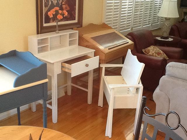White writing desk with chair, storage in bottom of chair.