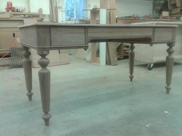 Walnut writing desk, with leather top.