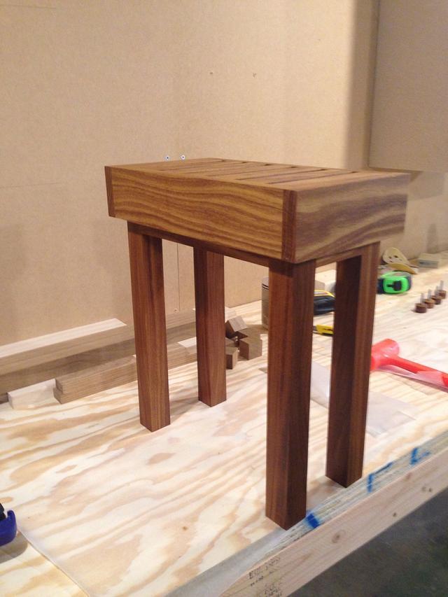 Small teak shower bench