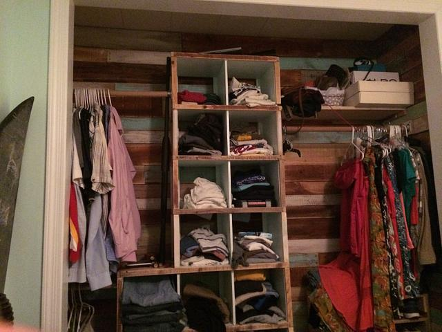 Closet lined with pallet wood