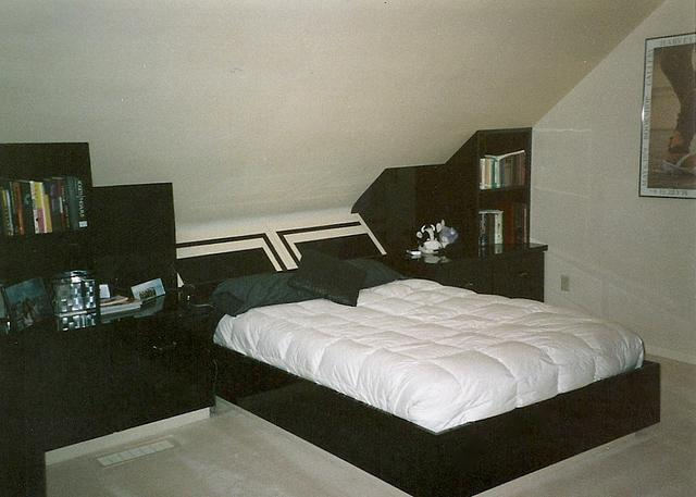 Casework: Laminate bedroom cabinetry, bed frame, and headboard