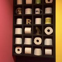 A shelf with a new roll